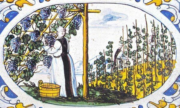 Mönch bei der Weinlese, Motiv auf dem Kachelofen im Sommerrefektorium von Salem